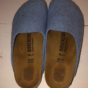 Baby blue Birkenstocks closed in.